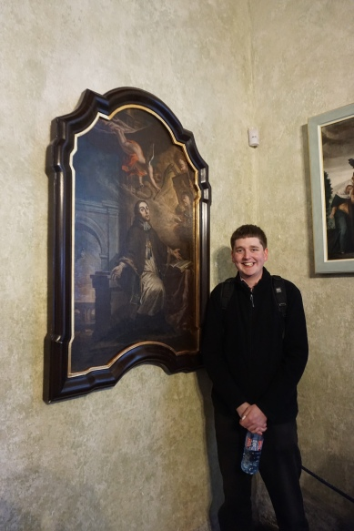 Jonathan with a portrait of St John of Nepomuk (the saint of the church we sang at!) (Credit: Colin Davis)